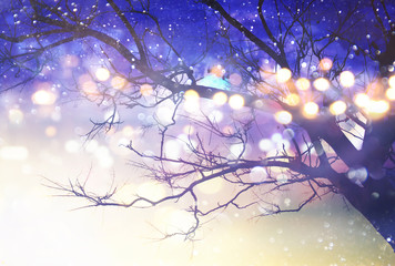 Abstract and magical image of tree with glitter lights