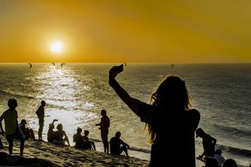 People at Top of Dune at Jericoacoara Beach