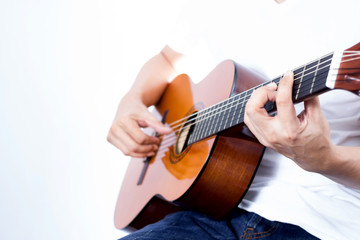 asian young musician playing acoustic guitar