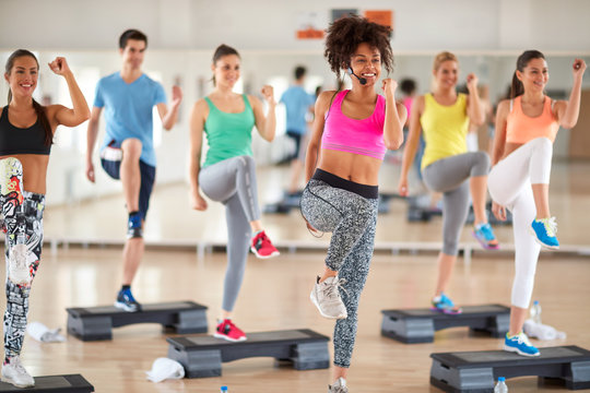 Female trainer lead group training in fitness center