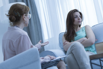 Psychiatrist explaining something to the patient