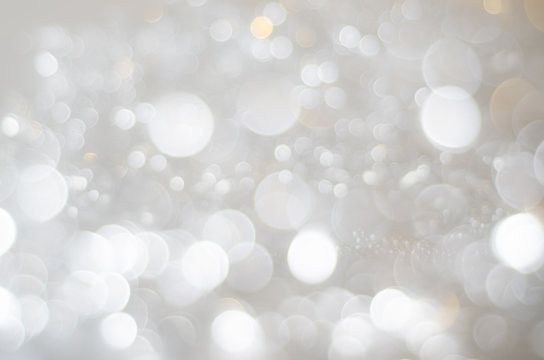 White, Silver and Gold Bokeh Texture Background