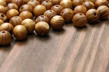 wooden beads close-up on a background of wooden boards.