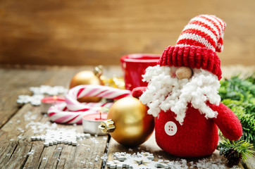 dark wood background with Santa Claus and Christmas ball. toning. selective focus