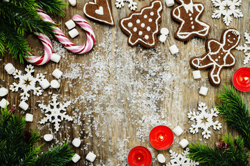 wood background with Christmas tree, candy, cookies, marshmallow
