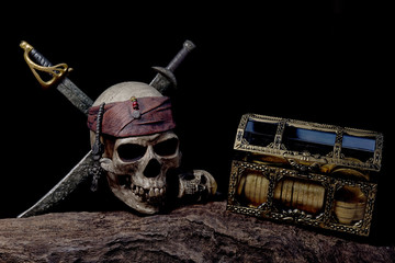 Pirate skull with two swords and coffer