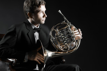 Photo sur Aluminium Musique French horn player portrait. Elegant man classical musician