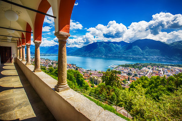 Beautiful view to Locarno city, lake Maggiore (Lago Maggiore) and Swiss Alps from Madonna del Sasso Church in Ticino, Switzerland. Wall mural