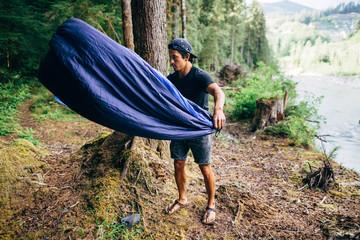 Man with sleeping bag