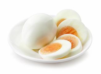 sliced egg on white plate