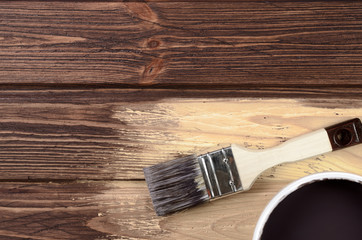 Process of painting the wood boards with the brush and the brown