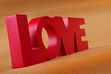 Lettering Love on orange background