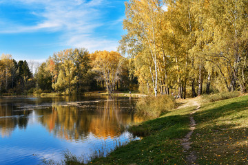 The path near the lake shore in autumn day