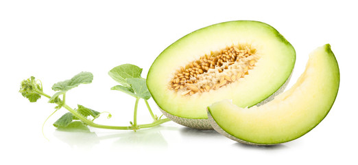 Green cantaloupe melon and leaves on isolated