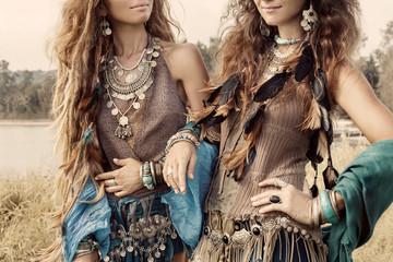 Two beautiful boho girls in ethnic jewelry. Close up