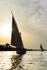 "Cairo, Egypt - Traditional boats named ""Felluca"" in Nile River at sunset"