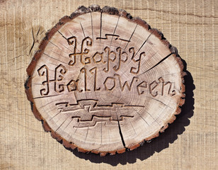 Happy Halloween. Carving on a log. handmade. Photos for your des