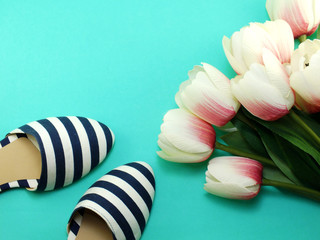 womens flats shoes and tulips flower on green background