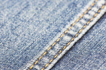 Blue denim with yellow stitching.