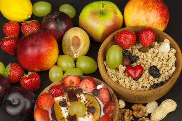 Healthy breakfast with cereals and colorful fruits. Yogurt with fruit and oatmeal. Meals for successful athletes. Food for kids.