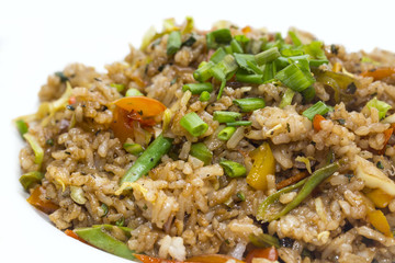 pilaf with vegetables on a white background in the restaurant