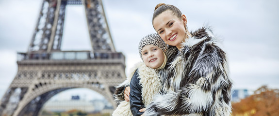 mother and child in front of Eiffel tower in Paris embracing