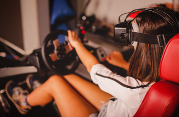 Woman playing game in virtual reality glasses