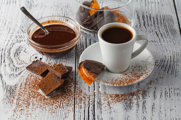 Cup of coffee and sweets on a white background