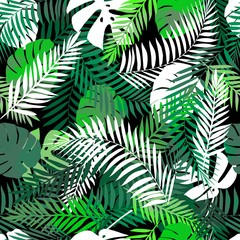 Seamless tropical pattern with palm leaves for fabric design or other uses. Endless exotic background with jungle pattern.
