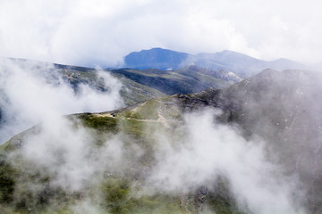 Landscape from Bucegi Mountains, part of Southern Carpathians in Romania in a very foggy day