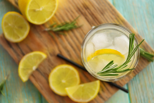 Cold fresh cocktail with lemon on cutting board