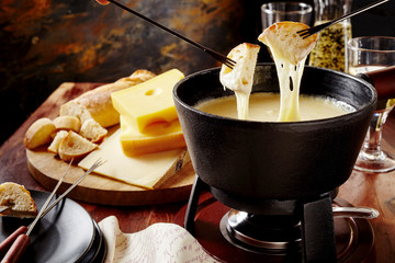 Gourmet Swiss fondue dinner on a winter evening