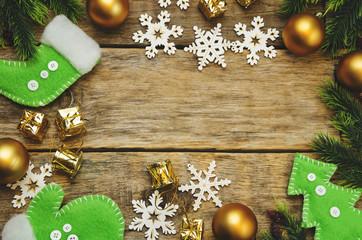 wood background with Christmas tree, snowflakes, Christmas balls