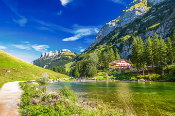 Fototapete - Tourquise clear Seealpsee with the Swiss Alps (mountain Santis) in the background, Appenzeller Land, Switzerland