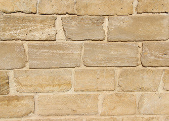 Old wall made of sandstone blocks