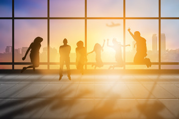 Silhouette group of business men and women happy jumping on sale