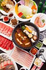 Deurstickers Picknick A special hot pot in Chinese style with beef, pork, seafood, mus