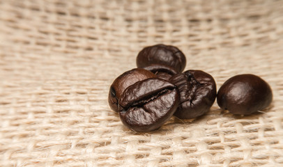 roast coffee beans isolated on sack background