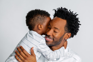Young African American Son Hugs His Father