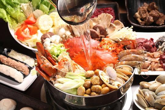 Supper crab hot pot with mushroom, clams, shrimps, corn and vege