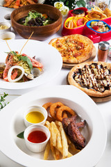 Special meal with fried octopus, shrimp, pizza, seafood soup buf