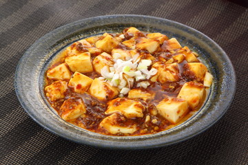 Mabo tofu with tomatoes soup and onion on chinese plate