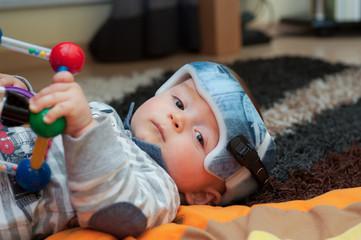 Baby in orthopedic helmet