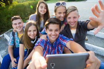 teenagers make selfie