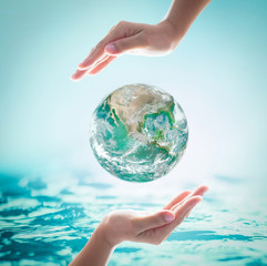 Collaborative female human hands on blurred wavy clean water background: Saving water clean natural environment ocean concept/ campaign: Love earth, save water conceptual idea/ sign
