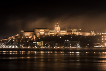 Budapest parliament at night over the Danube river