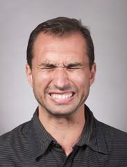 Studio portrait of a distraught man
