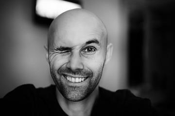 brutal portrait of a happy bald man bristles