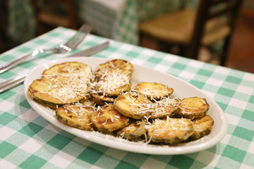 Fried squashes dusted with cheese