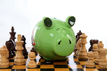 Piggy bank on chess board
